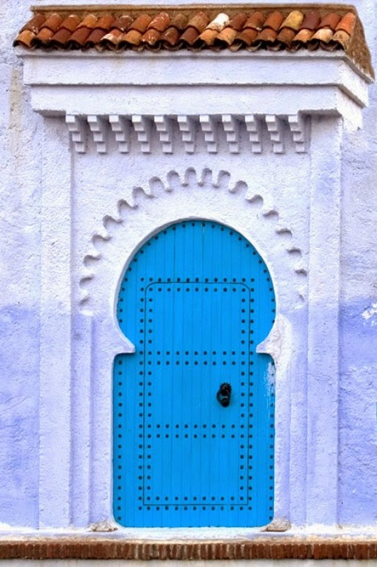 Blue door with nailhead details