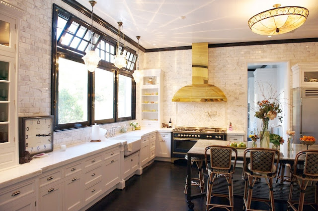Kitchen with marble subway walls, white cabinets, dark wood floors, black trimmed windows, vintage light fixture over the island and Drucker's French Bistro barstools