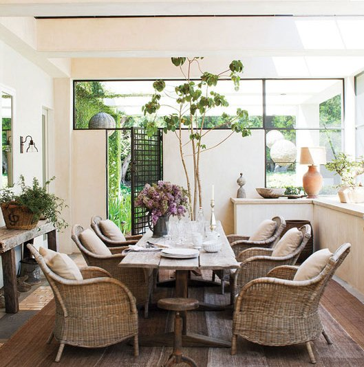 A Covered Enclosed Sun Porch In T.v. Star Ellen Degeneresu0027 Home Boast A  Rustic Dining Table Surrounded By Wicker Arm Chairs. (above)