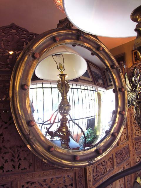 Round wood framed convex mirror