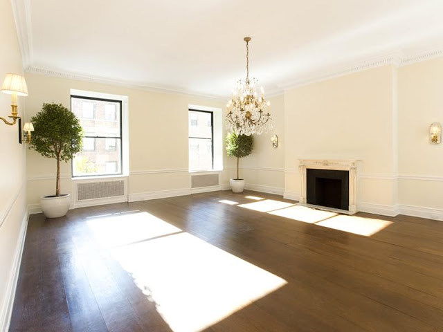 Dining Room/Family Room with wood floors, a chandelier and a fireplace