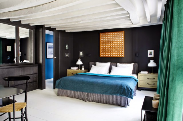 Dark wood bedroom in a Paris apartment with pops of color