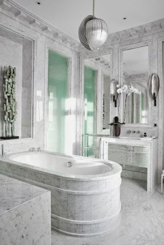 Grand marble bath in a Paris apartment designed by Jean Louis Deniot