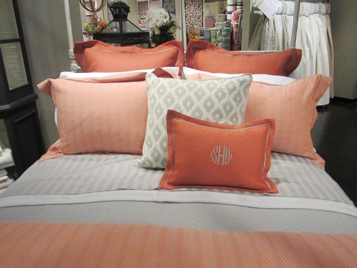 Close up of the elegant coral and grey pillows from Peacock Alley