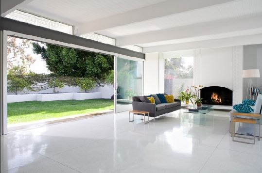 Living Room With A Large Glass Sliding Door White Tile Floor Fireplace And