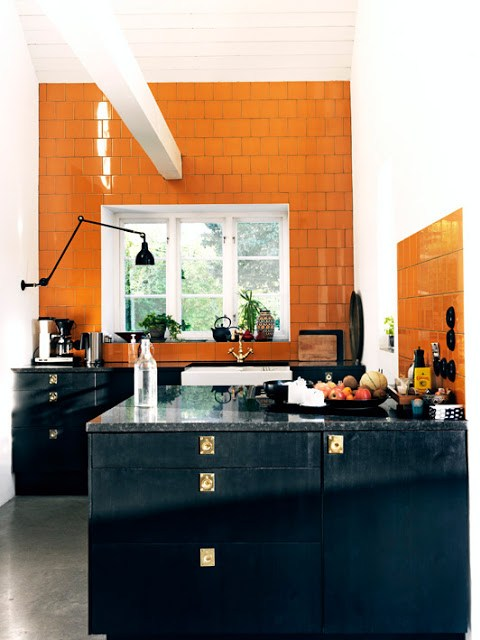 kitchen orange ceramic wall tiles black cabinetry cabinets gold drawer pulls knobs