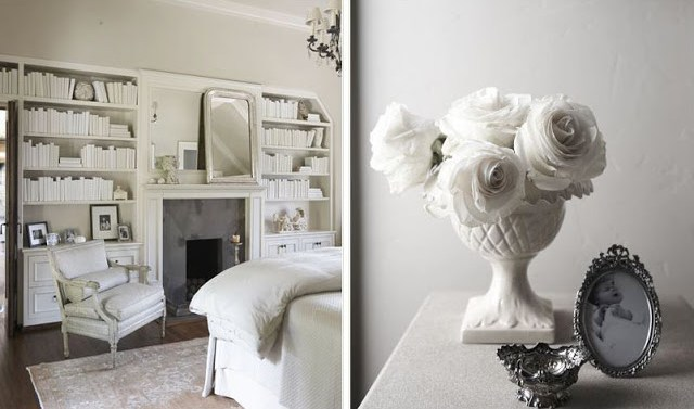 (L) Bedroom with white built in bookshelves, a fireplace with a white moulded mantel, a white armchair, dark wood floor and a large area rug. (L) Close up of white side table holding a white vase holding white roses, a black and white baby photo in an antique silver frame and an antique silver memento