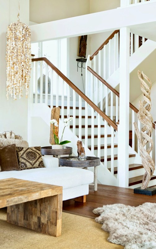 Staircase in a Swedish farm house with seashell light fixture