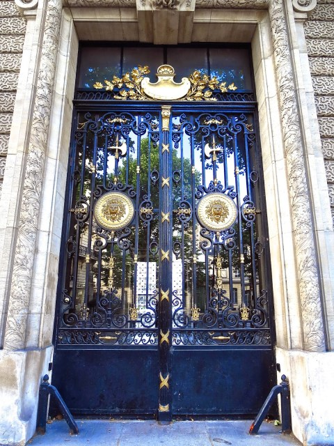 Metal and glass door in Paris with gold medallions