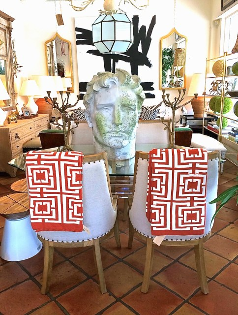 COCOCOZY Logo throws in burnt orange at Mecox Gardens West Palm Beach