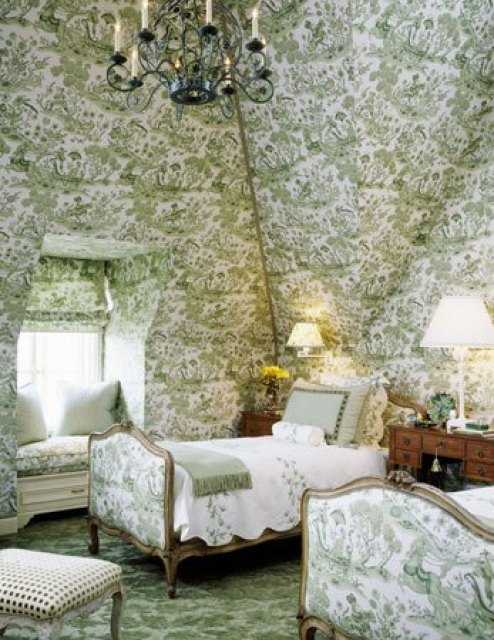 Green toile walls and floor match a the green toile upholstered french twin beds in a statement classic bedroom