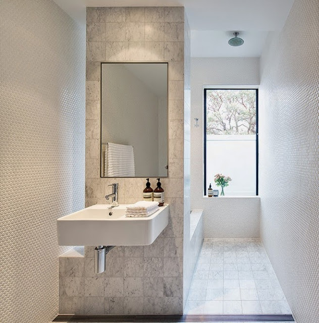 Bathroom with mix and match tile walls
