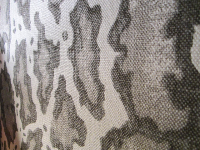 Close up of Peter Dunham's animal print Gattapardo linen fabric upholstering the walls in a sitting room in the House of Windsor