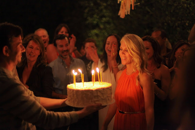 Chris Bender delivers a huge birthday cake to his wife Kristi