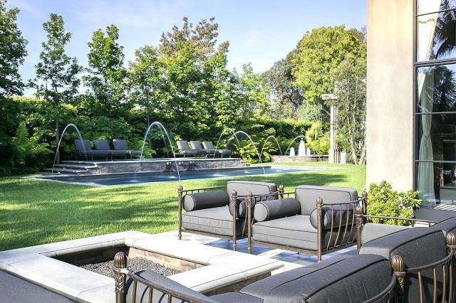 Backyard fire pit pool fountains metal outdoor chairs grey cushions