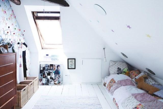 Bright white girls loft bedroom with dark wood dresser
