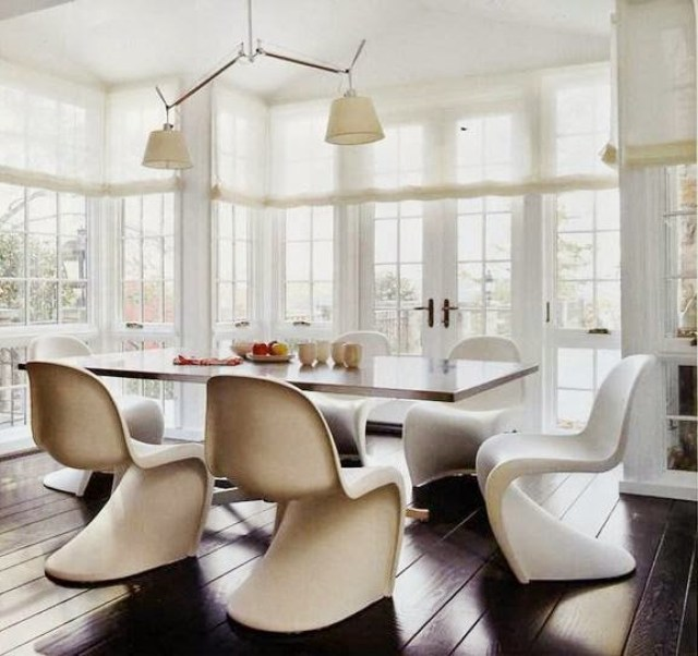 Dining room by Darryl Carter with white Panton chairs