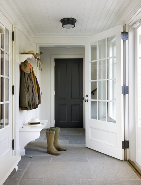 boots on a store floor in a mudroom with white paneled ceiling