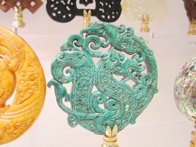 Chinoisserie inspired dragon finial carved out of green jade