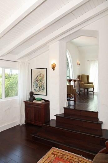 Foyer in a 1920's Spanish style home with dark Koa wood floor