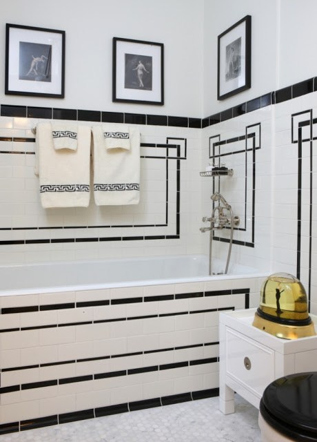 Jessica Lagrange's black and white tiled bath tub and white towel holder stand