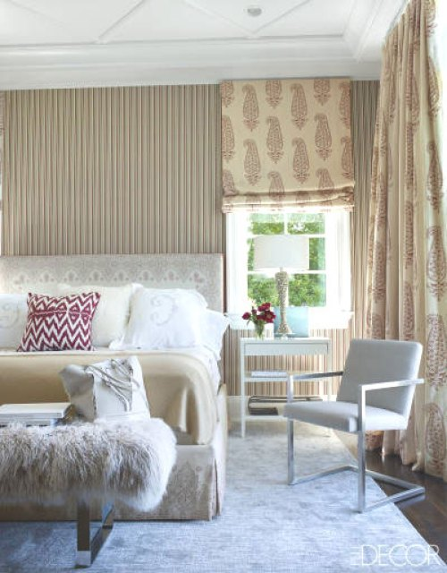 Bedroom with stripped wallpaper in Tamara Mellon's home