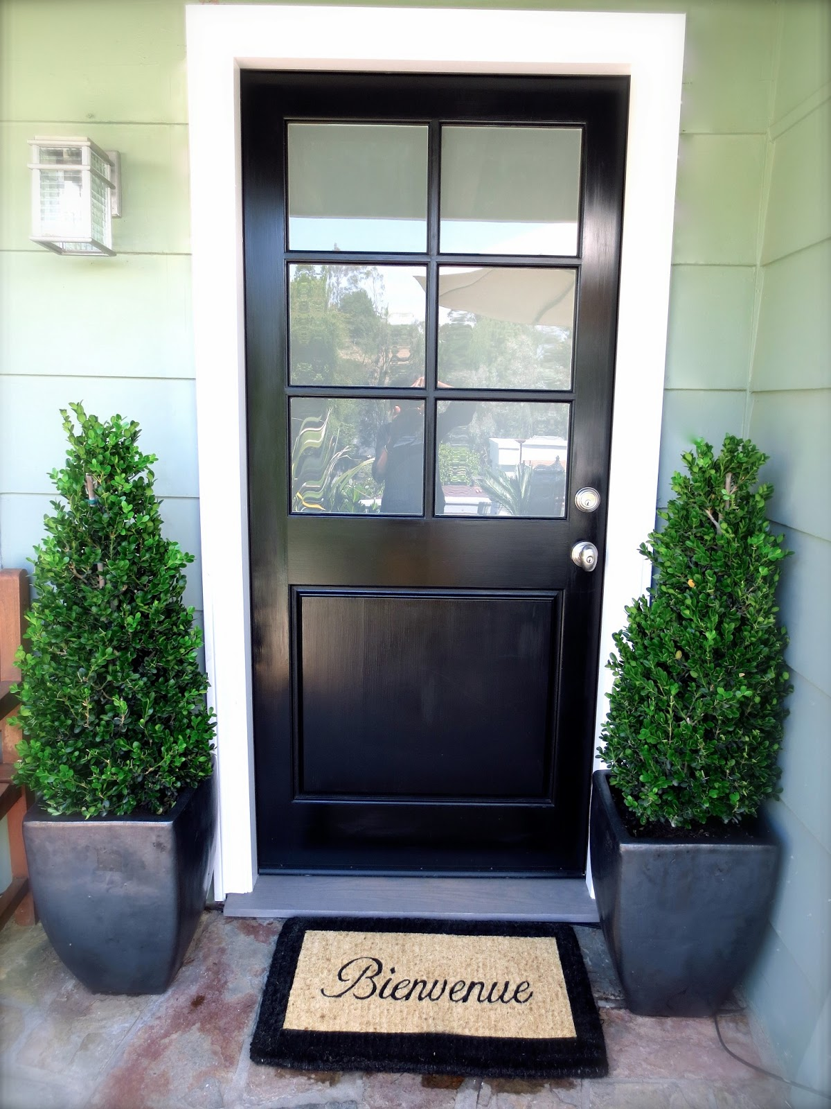 Doormat picks for my black front door cococozy black front door glossy boxwood topiaries plants potted charcoal gray ceramic planters bienvenue doormat rubansaba