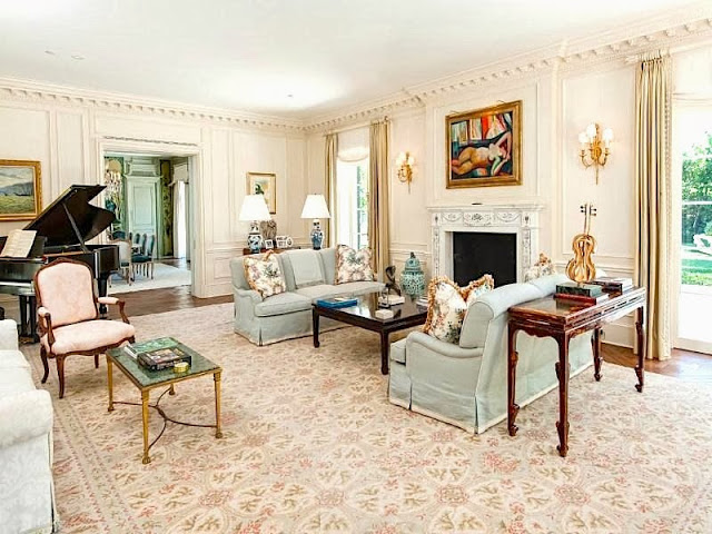 Traditional living room in a Palm Beach estate with paneled walls, dentil molding and a grand piano