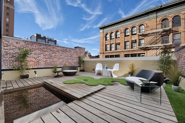 deck with white panton chairs, exposed brick walls and wood floor