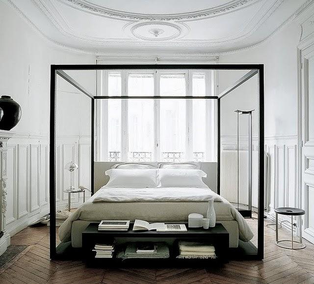 Black and white bedroom with herringbone wood floor