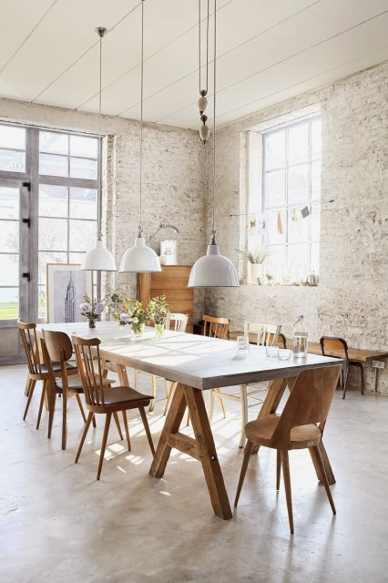 Bright dining room with mismatched chairs