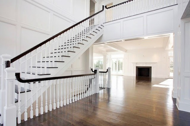 foyer with a grand staircase and wood floor
