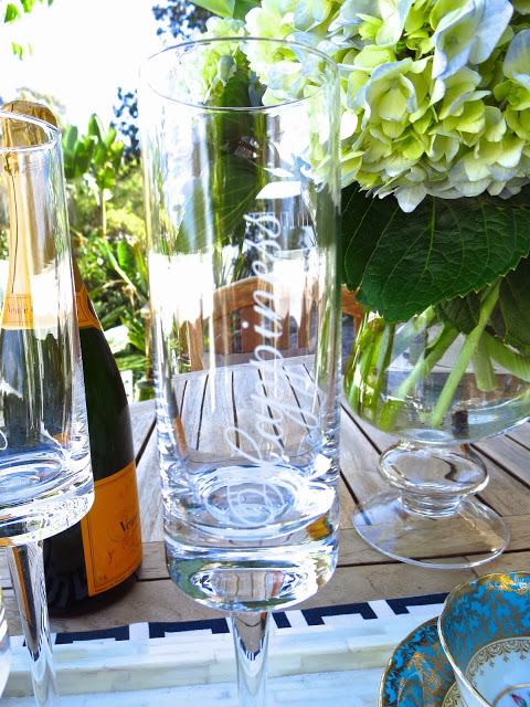 """Whimsical champagne flutes with the word """"Happiness"""" written on them"""