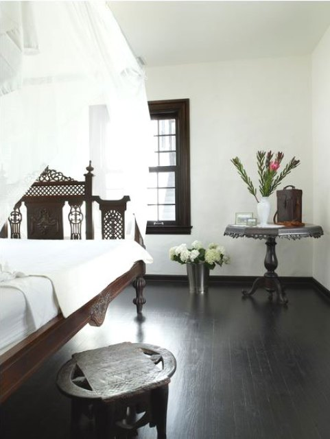 Bedroom with carved footboard