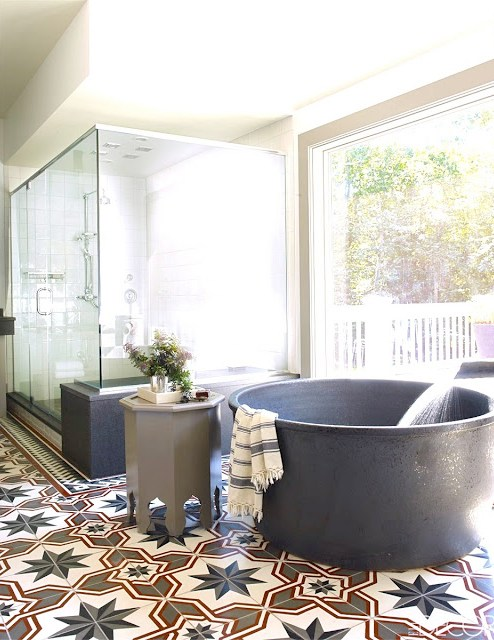 Bobby Flay celebrity bathroom Moroccan cement tile floor modern tub glass shower