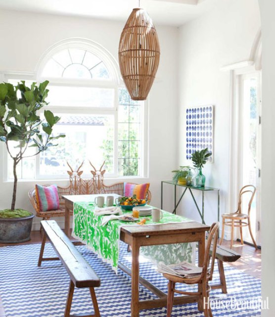 Todd Nickey and Amy Kehoe of Nickey Kehoe's breakfast nook in their Malibu home featured in House Beautiful with modern rustic wood table and green table runner