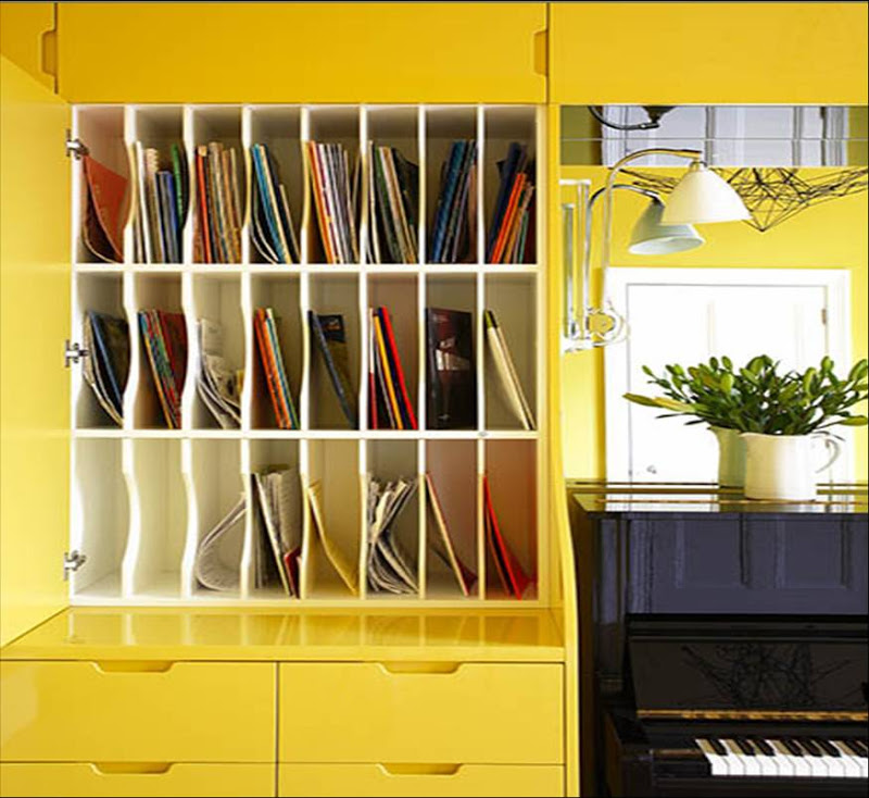 Bold glossy lacquer built-in cabinetry in a music room with a black piano