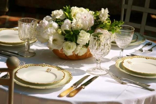 Wedding flower arrangement by Lily Lodge with white peonies and gardenias in a gold bowl