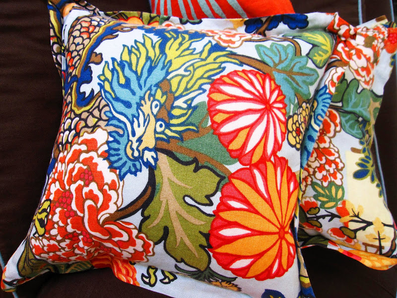 Schumacher's Chiang Mai Dragon fabric on a living room sofa accent throw pillow