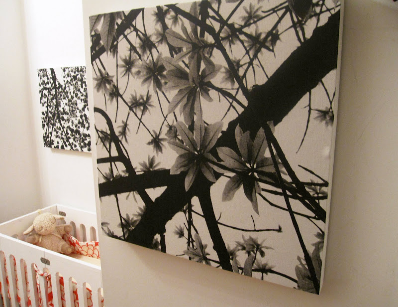 Black and white Asian inspired floral fabric stretched on square canvas frames in a nursery in a NYC loft