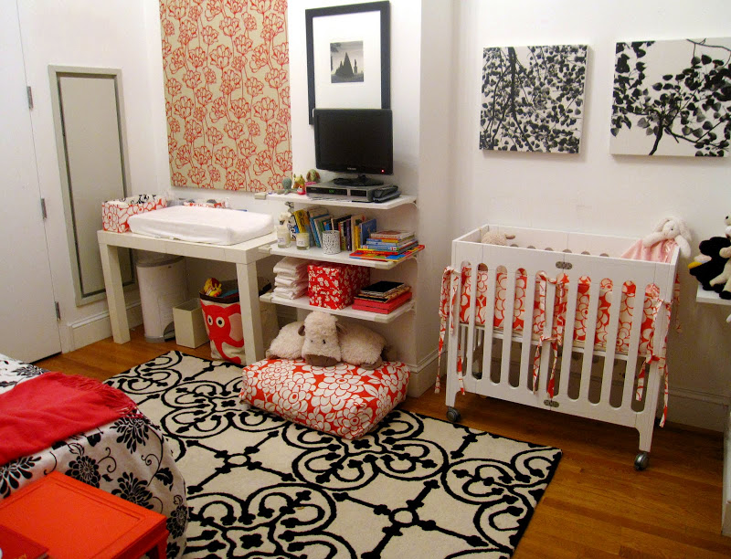 Colorful nursery in an NYC loft with stylish prints and florals