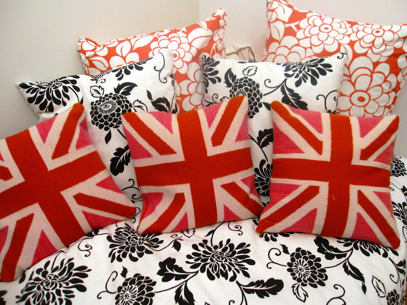 Jonathan Adler's British Flag pillows on black and white bedding on a daybed in a nursery
