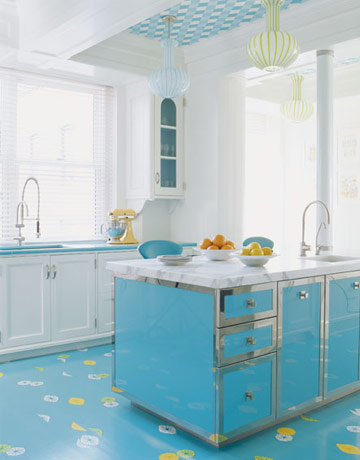 Turquoise kitchen with  matching island, floor and painted ceiling