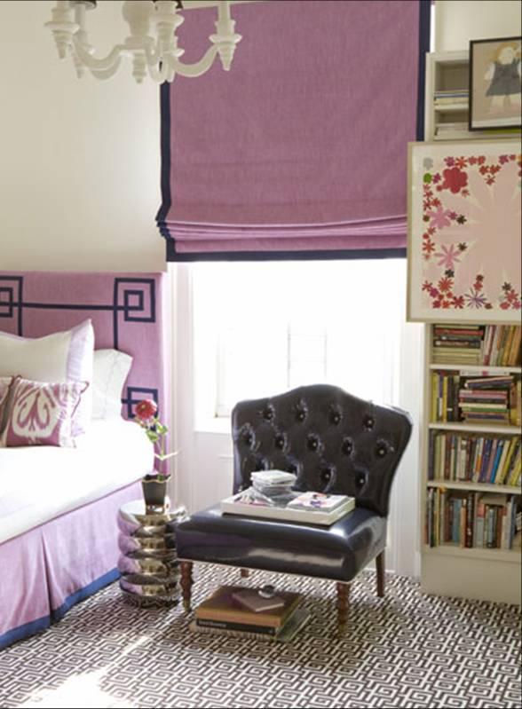 Posh bedroom with purple headboard and Roman shades with a dark ribbon trim