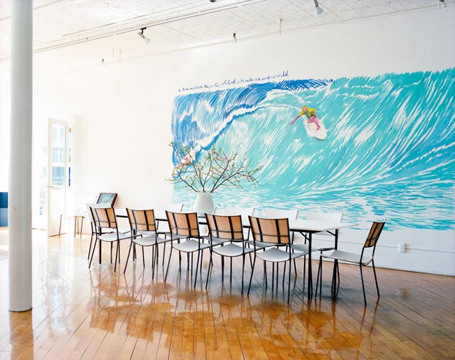 Modern dining room with a mural of a surfer by ngoc minh ngo