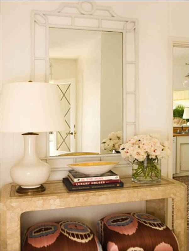 Foyer by Kristen Hutchins with faux bamboo mirror, simple console table with a lamp with a gold base and a bowl