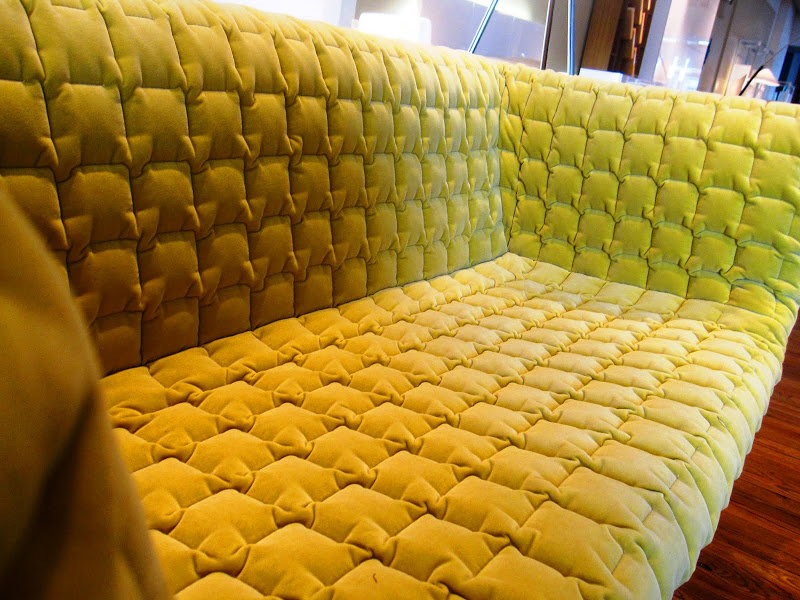 Close up of a green modern sofa from Ligne Roset