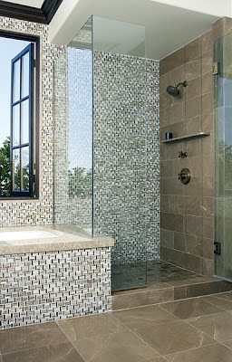 Bathroom with the shower and sunken tub covered in Erin Adams' triple basket weave glass mosaic and Suede limestone field tiles