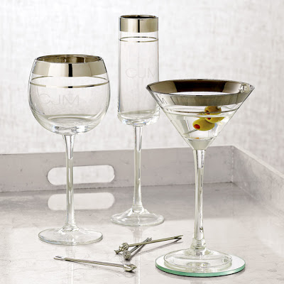 Clear champagne glass, a wine glass and a martini glass rimmed with platinum silver stripes from West Elm