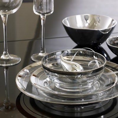 Dinnerware with clear glass plates rimmed with two striped metallic silver bands